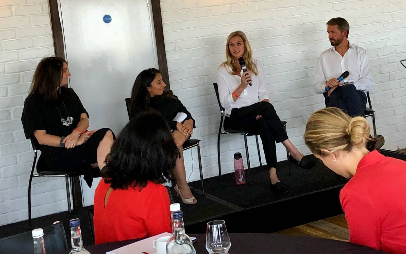 Holly Branson and Josh Bayliss speaking to two women at 100% Human at Work panel