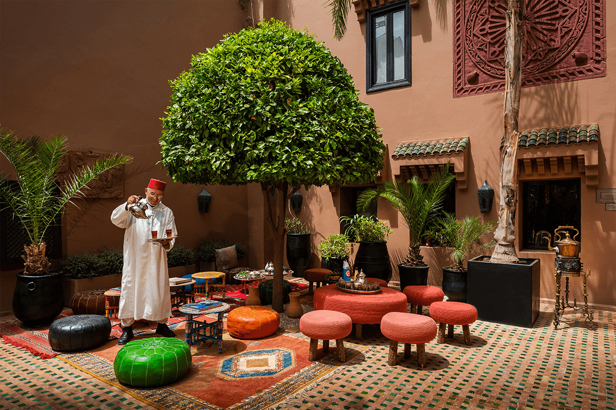 A man pours tea outside at Kasbah Tamadot