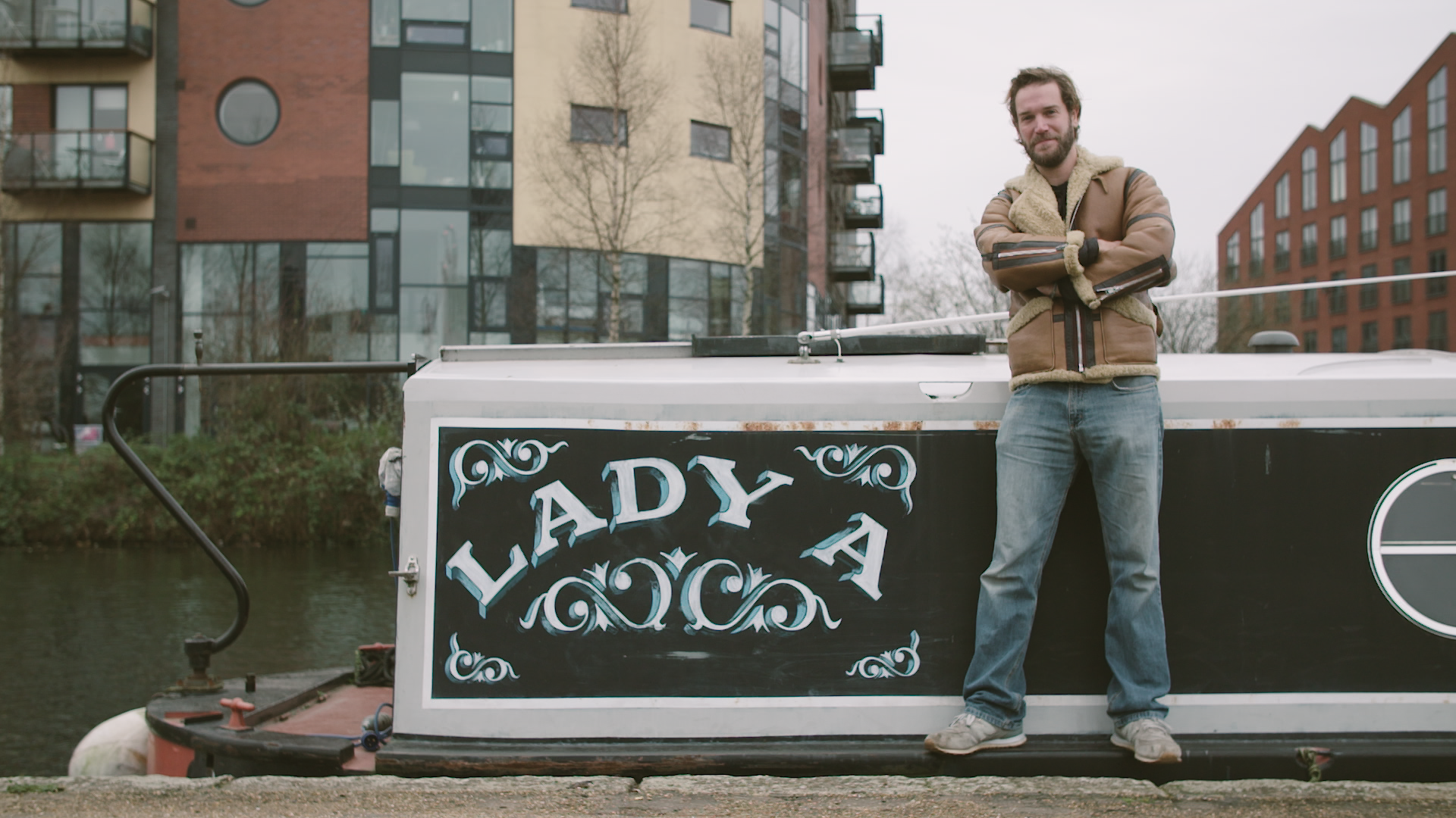 James Levelle stands in front of a narrowboat called Lady A