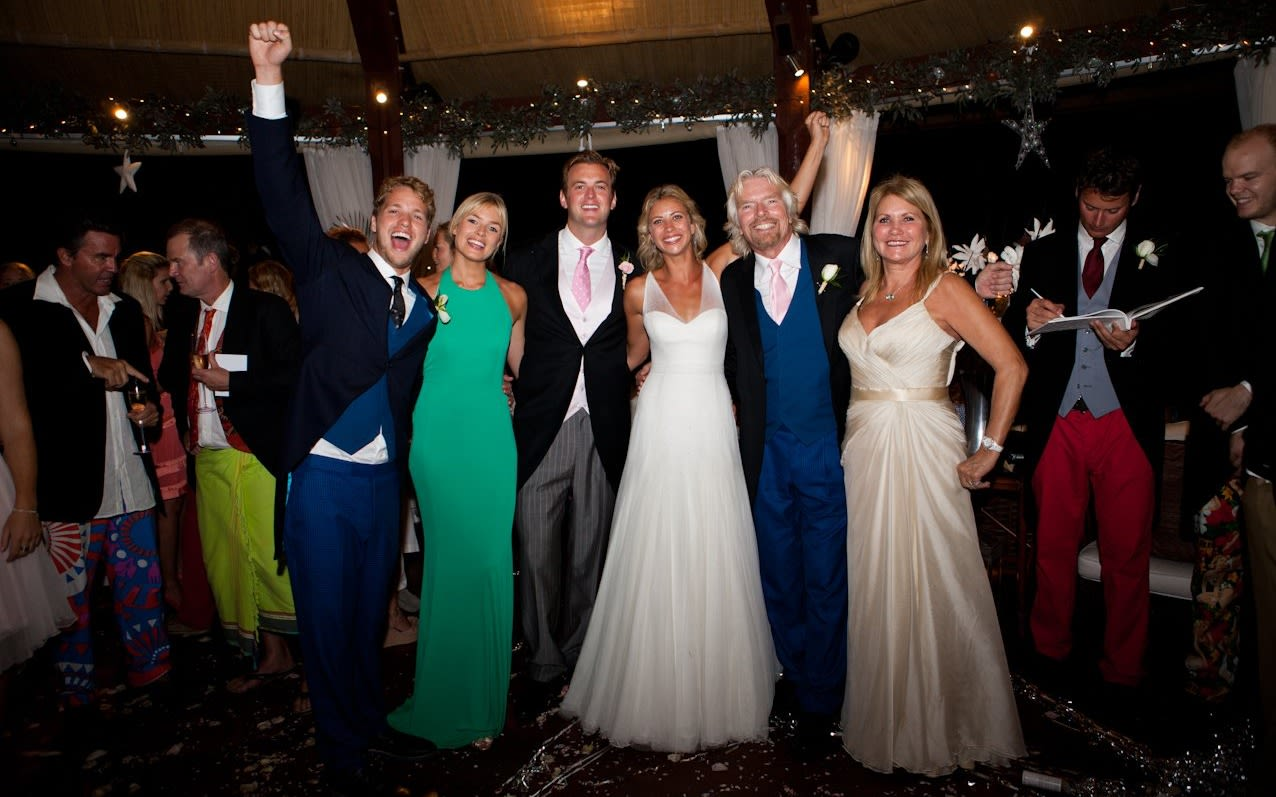Holly Branson and Freddie Andrewes pose for the camera at their wedding alongside Sam Branson, Bellie Branson, Richard Branson and his wife Joan