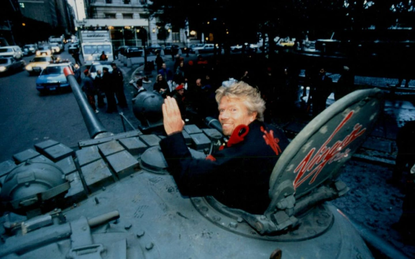 Richard Branson in a tank waving