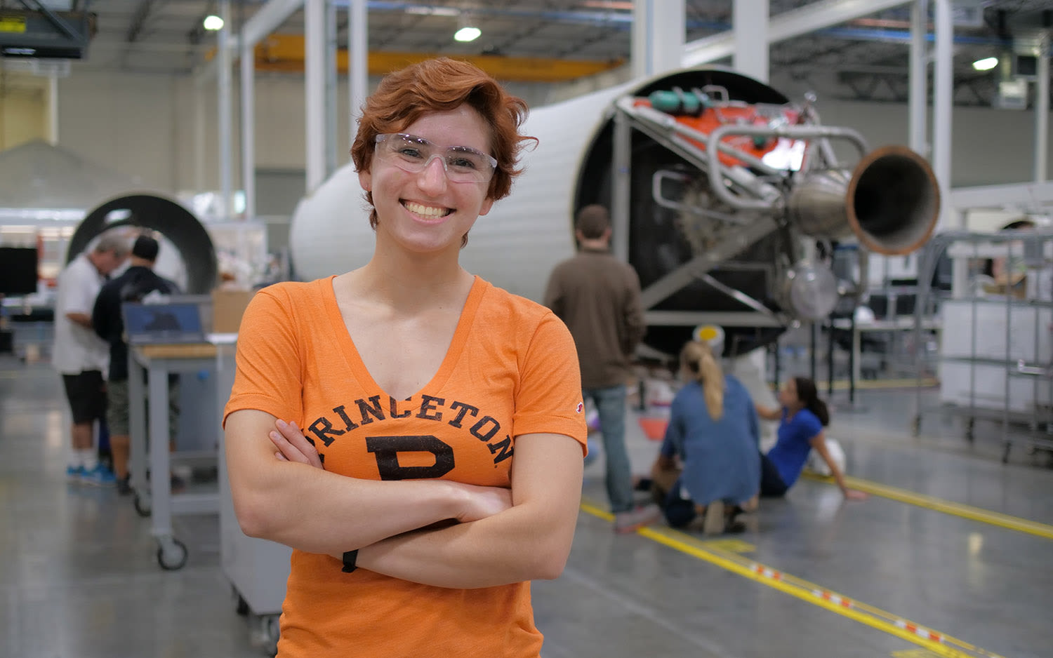 Isabel Cleff in front of one of Virgin Orbit's rockets, taken during her internship