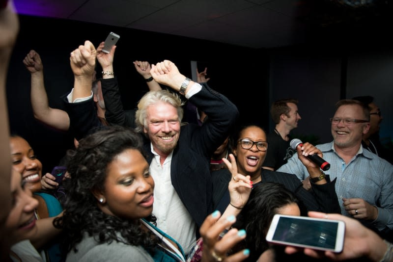 Richard Branson dancing with Virgin America team members