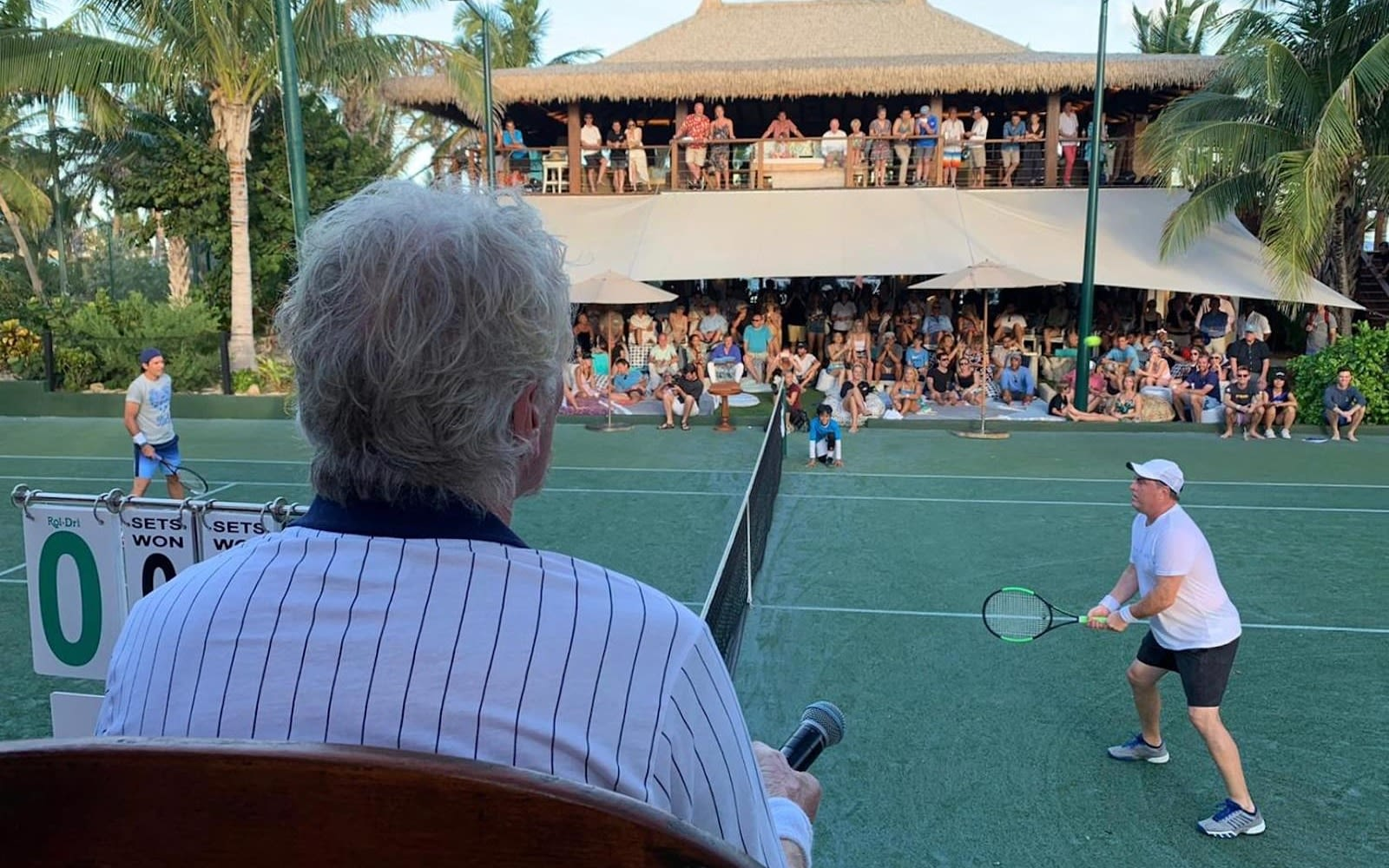 richard Branson watching a tennis match at the 2019 Necker Cup