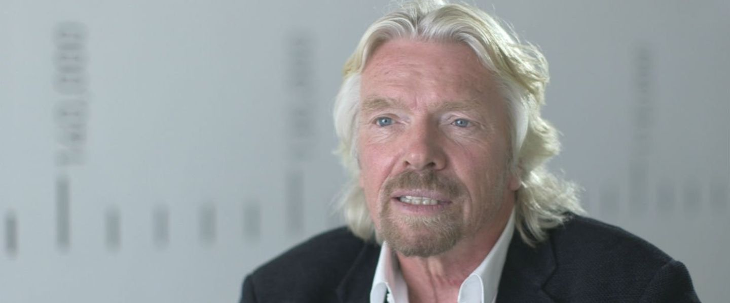 Richard Branson looking to the right of camera