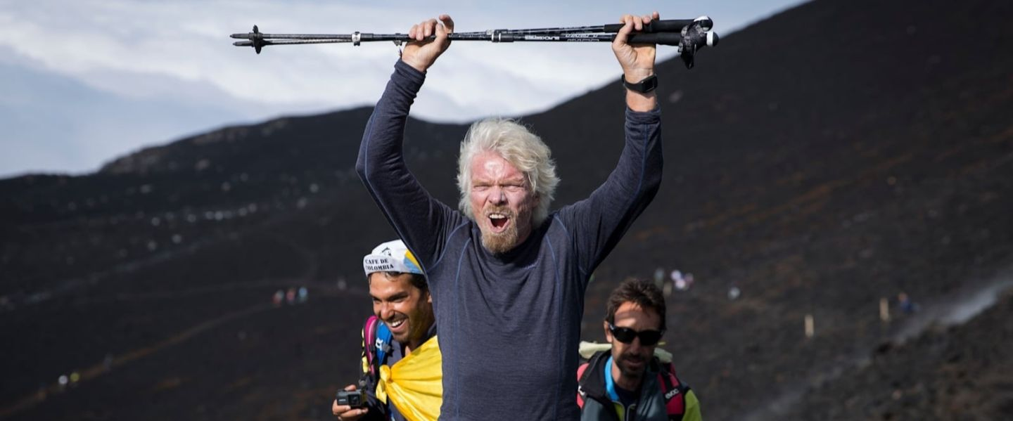 Richard Branson hiking and cheering