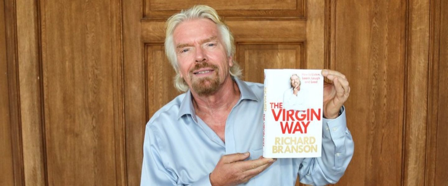 Richard Branson posing with his book 'The Virgin Way'