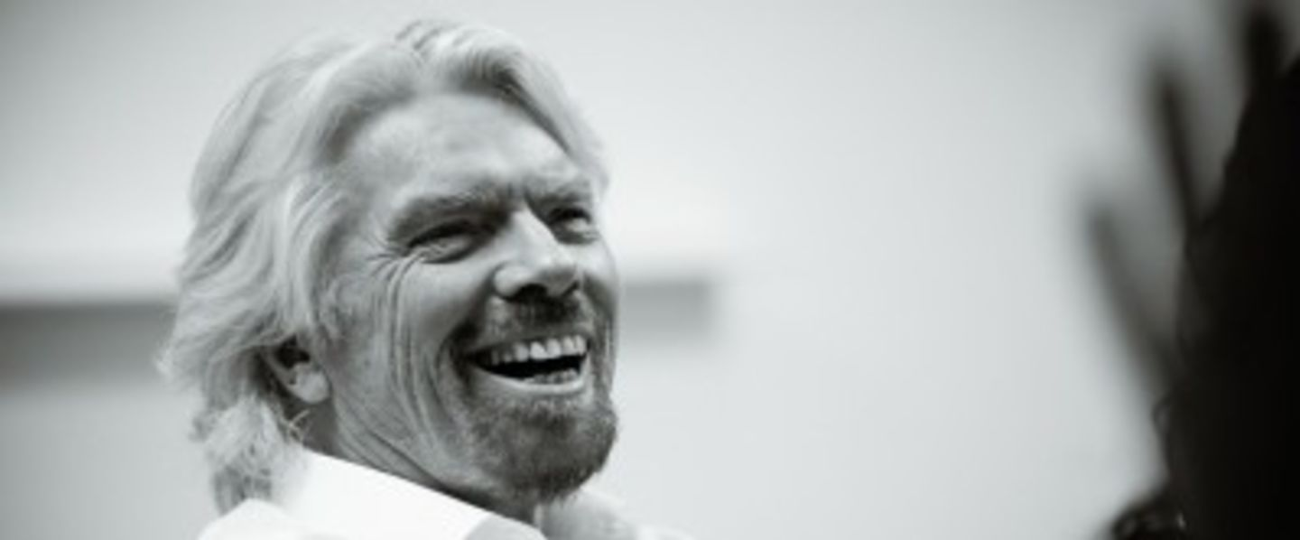 Black and white image of Richard Branson laughing