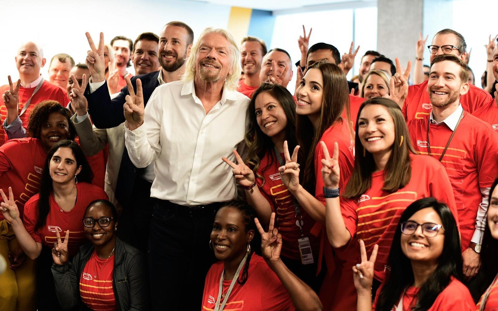 Richard Branson and the Virgin Trains USA team pose for a photo
