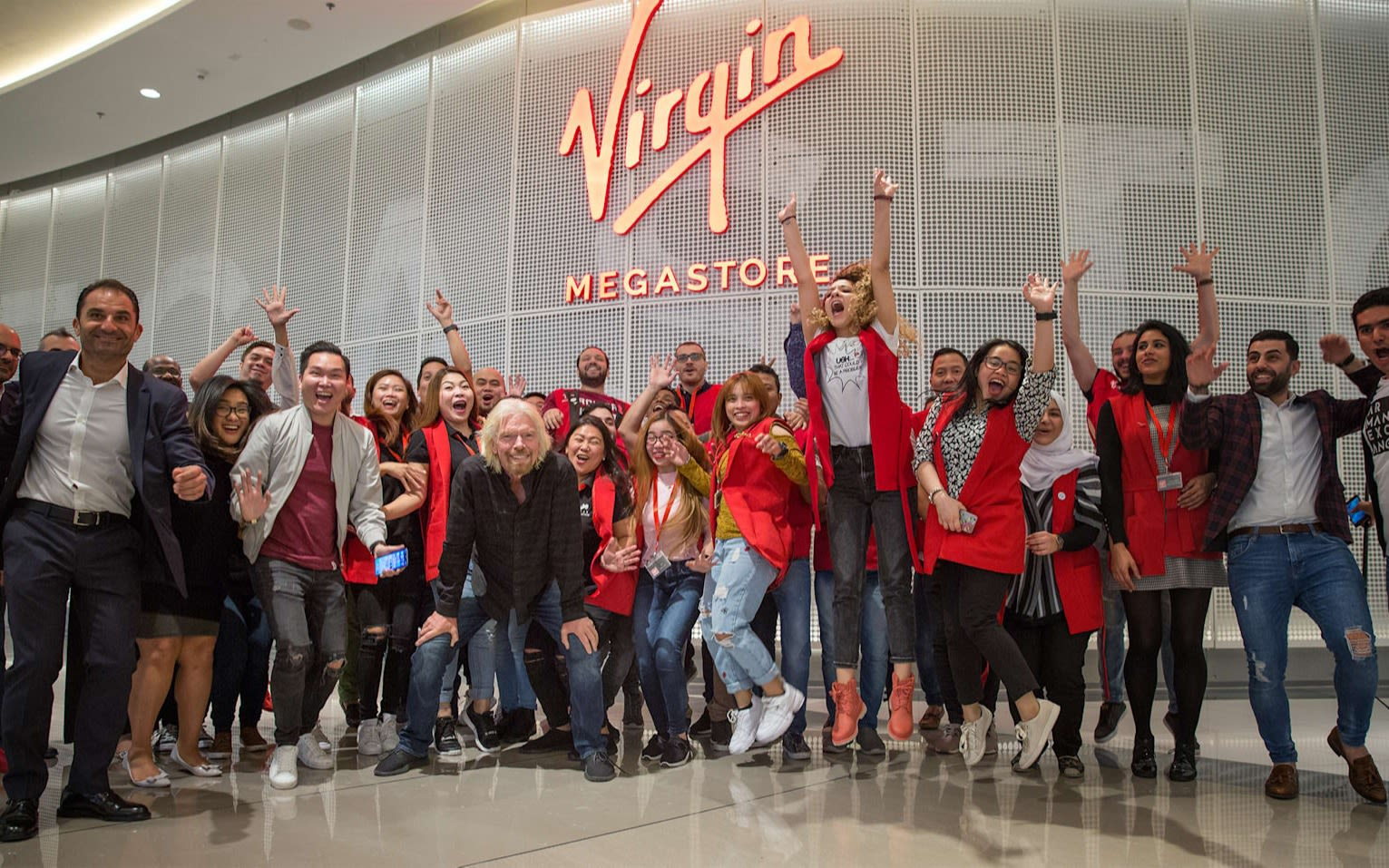 Richard Branson with Virgin Megastore employees