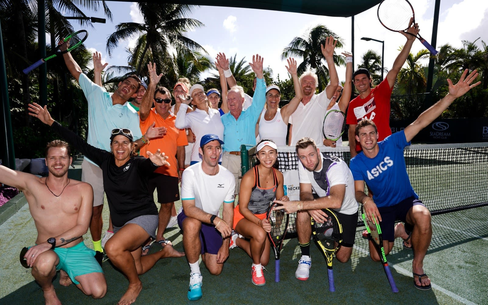Richard poses with a group of tennis players at the Necker Cup
