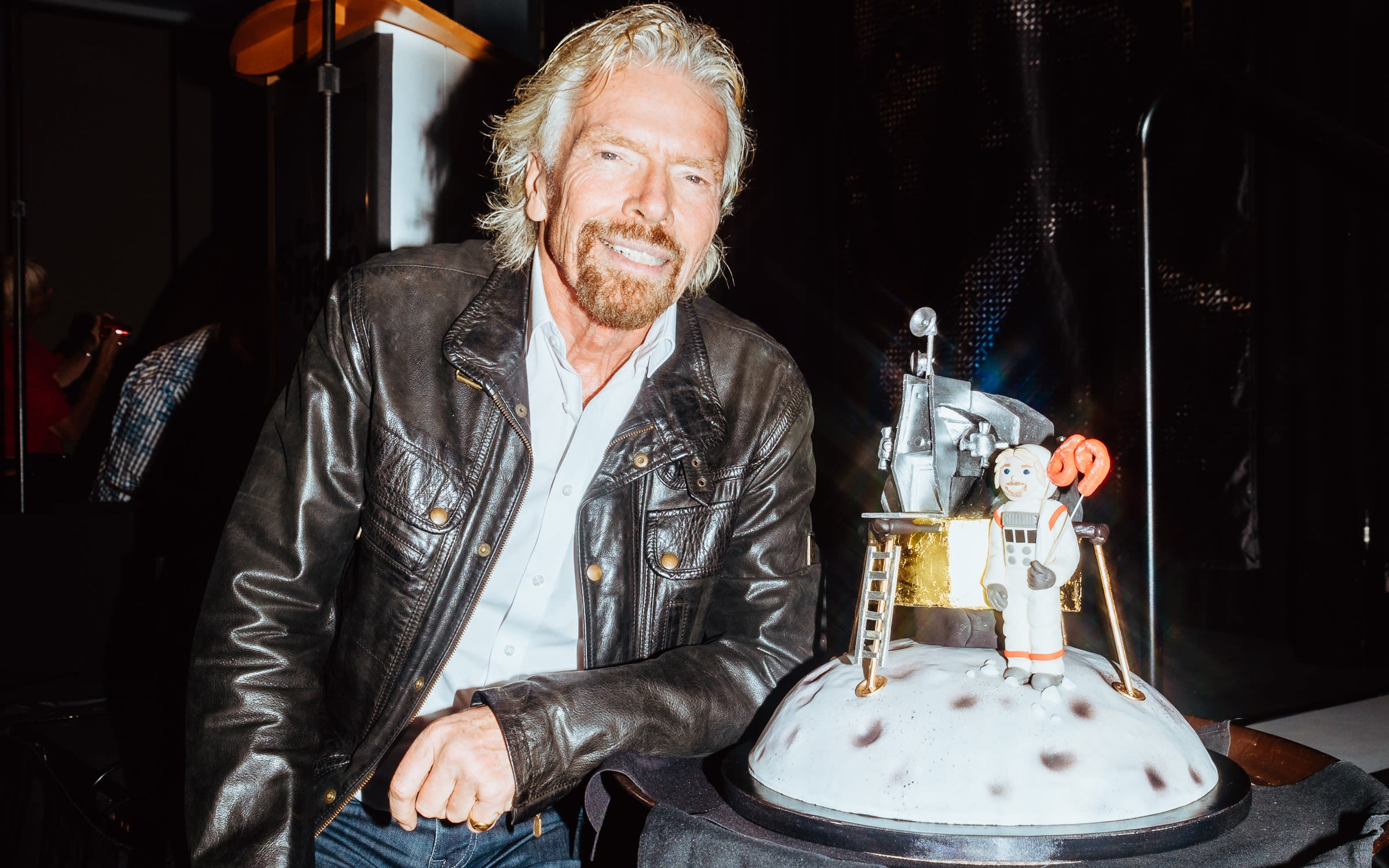 Richard Branson with his Virgin Galactic birthday cake for his 69th birthday