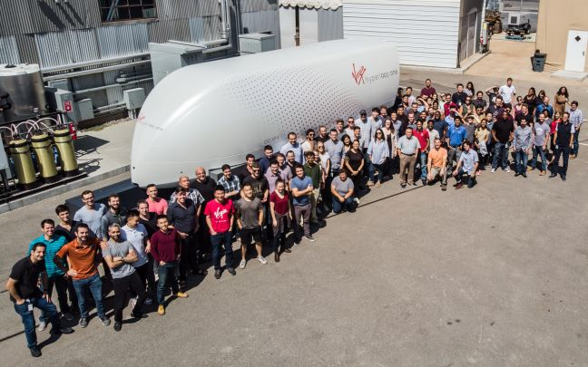 The Virgin Hyperloop team stand in front of the XP-1 pod