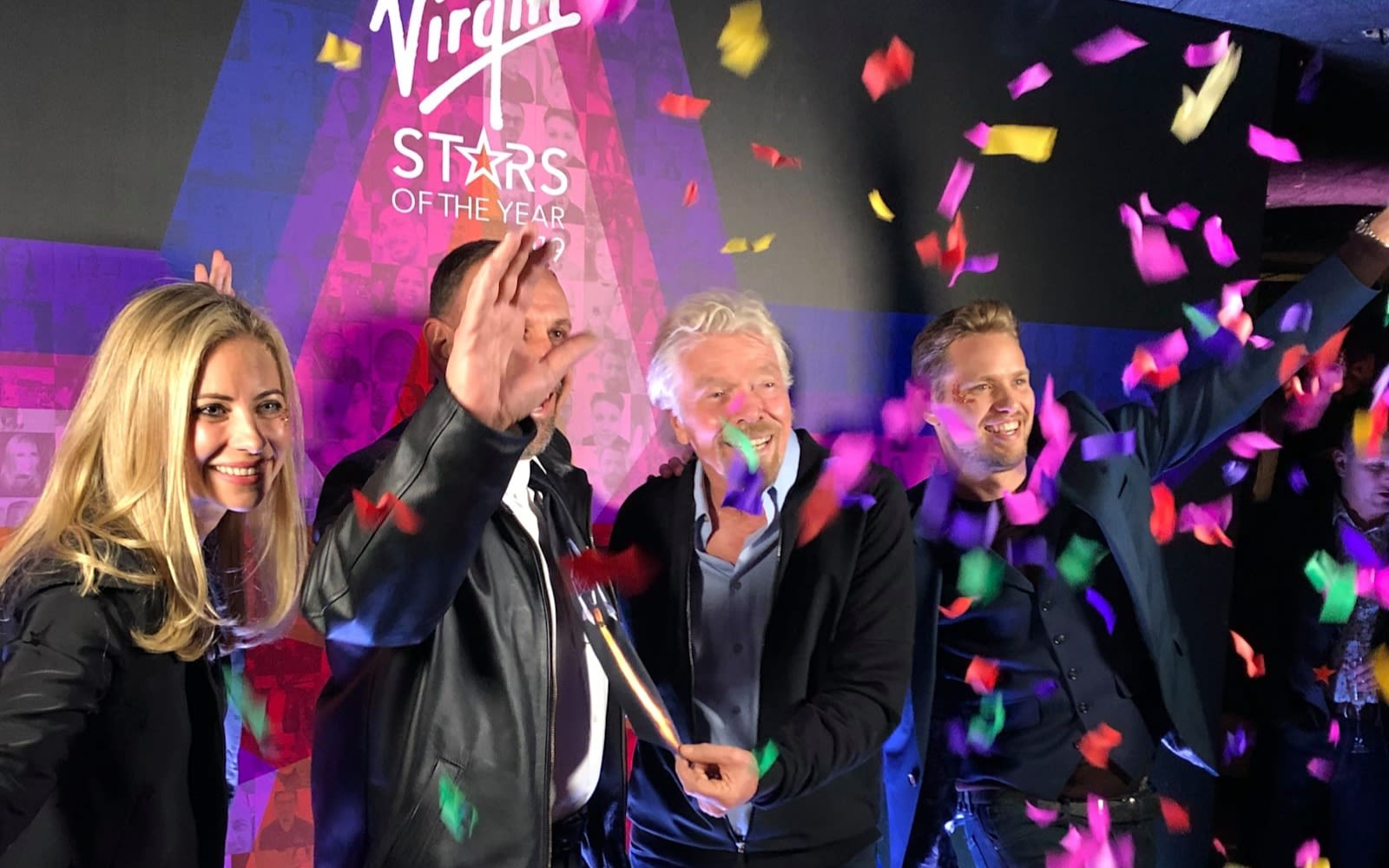 Richard Branson, Sam Branson, Holly Branson and a Virgin Galactic smile with confetti at a party