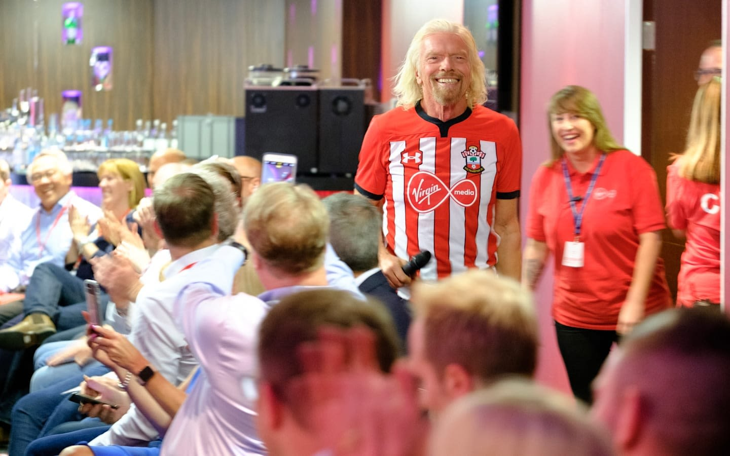 Richard Branson wearing a Southampton FC football shirt with the Virgin Media logo on