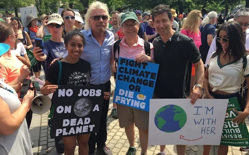 Richard Branson with a group of people on the climate march