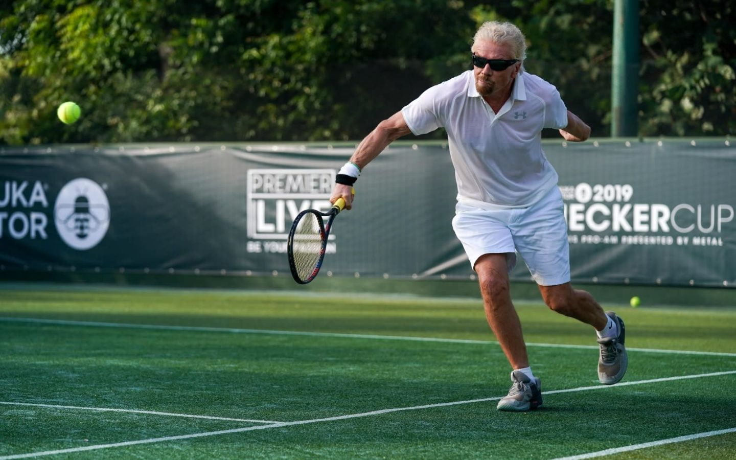Richard Branson playing tennis