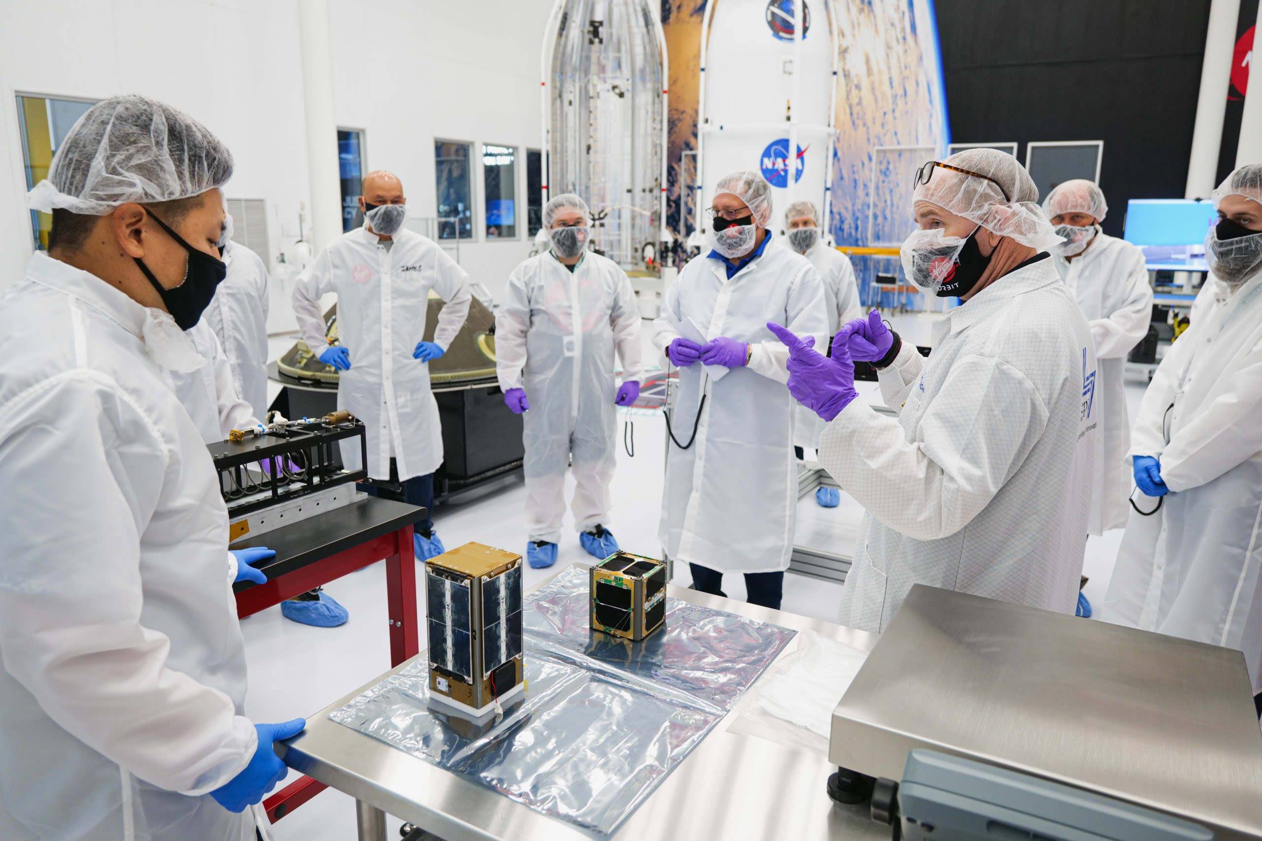 A team of Virgin Orbit technicians and payload customers conduct a final round of checkouts before integrating the spacecraft ahead of the company's Launch Demo 2 mission.