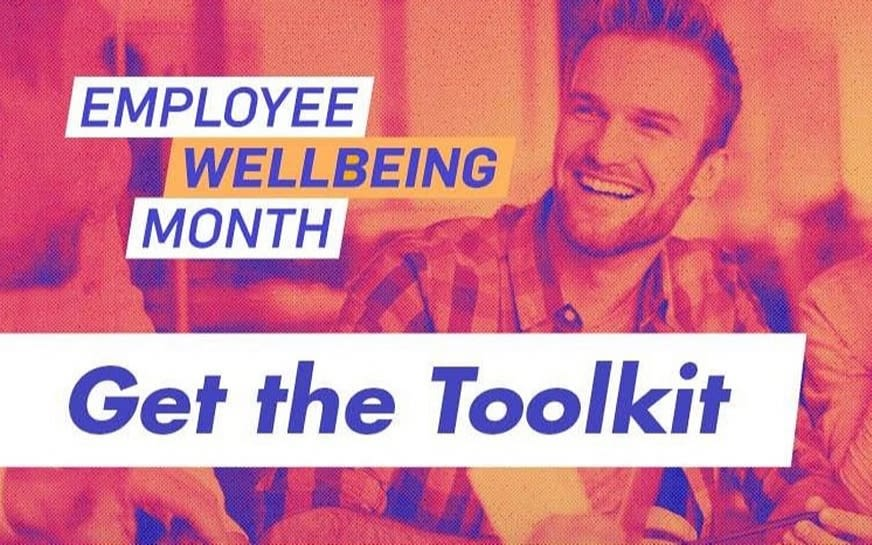 A man smiling, with the text 'Employee Wellbeing Month, Get the Toolkit', written over the image