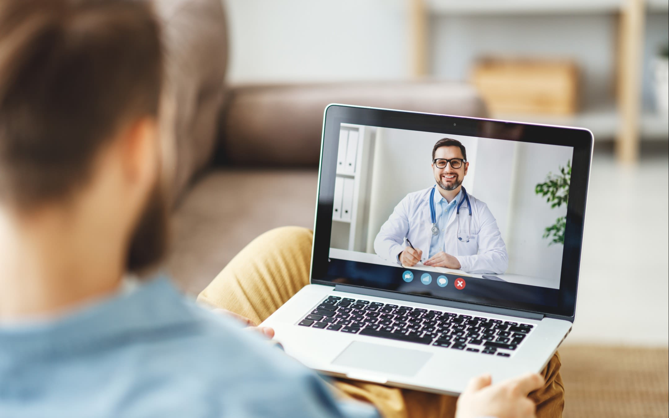 A doctor carries out a virtual consultation with a patient