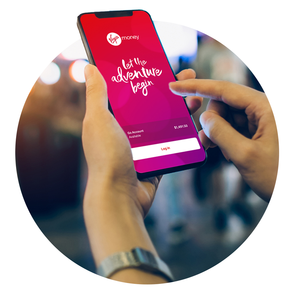 A hand holding a phone showing the Virgin Money Australia app