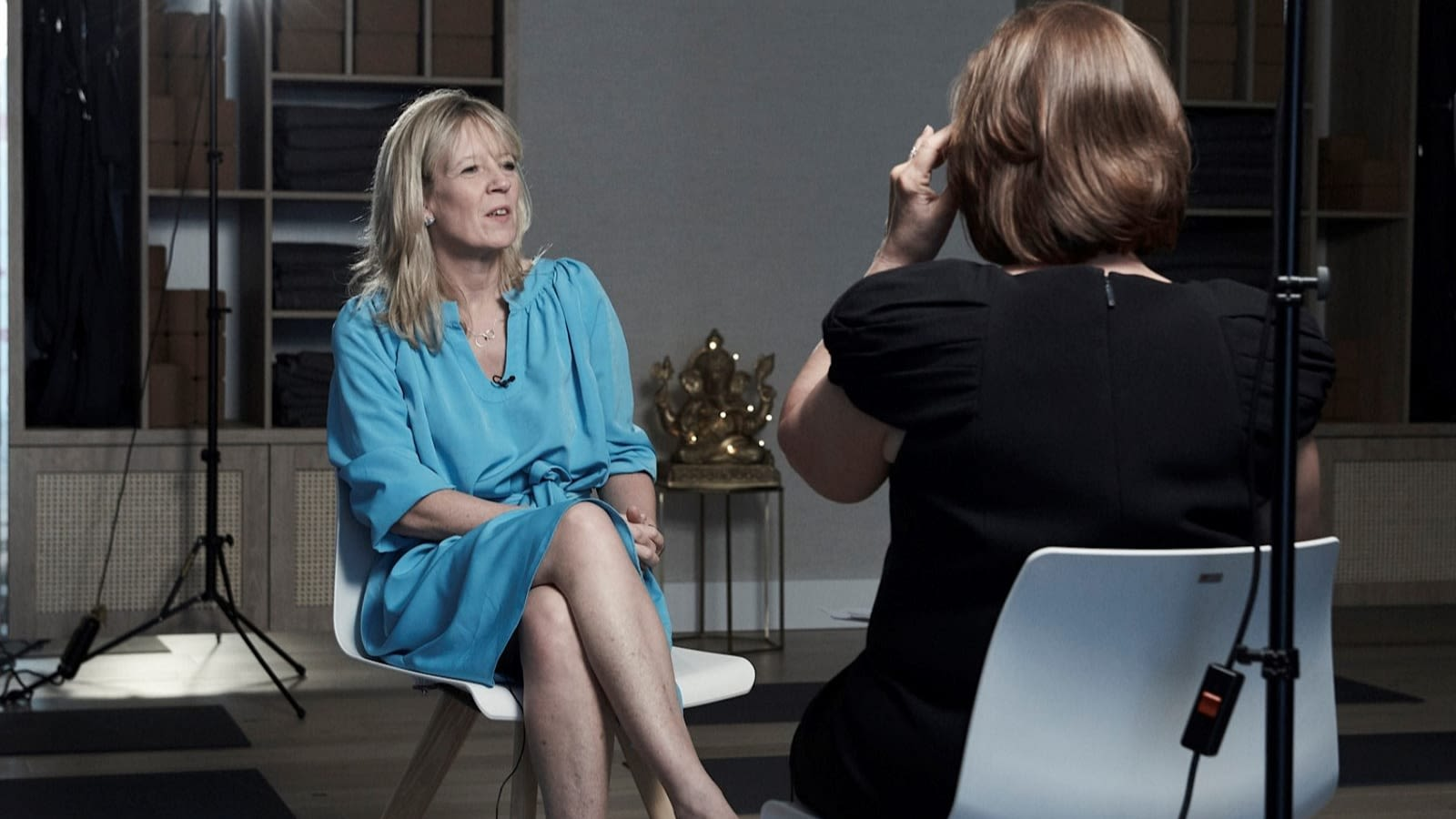 Lisa Thomas, Chief Brand Officer at Virgin, sitting on a chair facing another woman whose back is to the camera