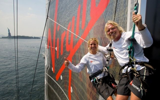 Richard Branson and Holly Branson on a boat during an attempt to break the world record for the fastest transatlantic crossing in a 99ft monoull sailboat