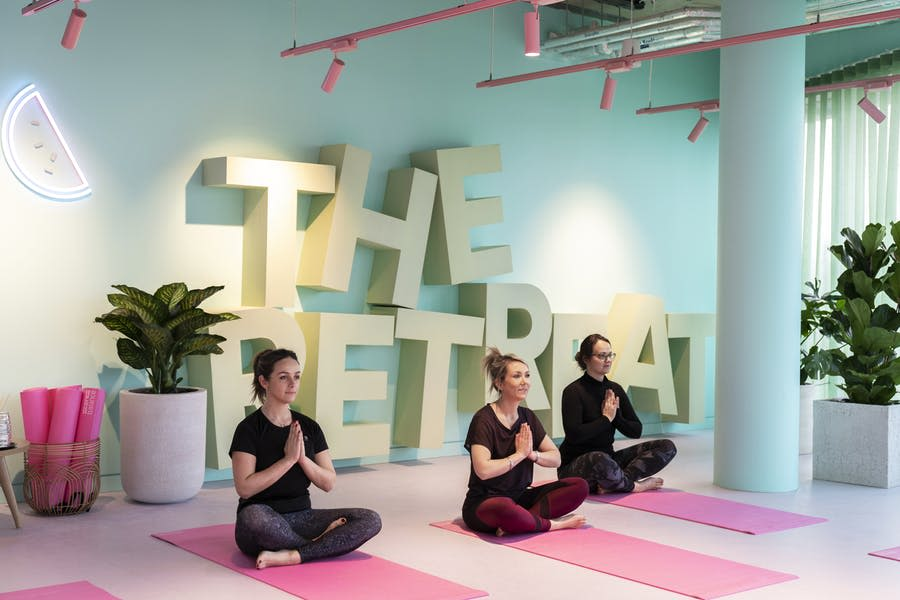 People practise yoga in The Retreat room at Virgin Media's new office in Reading