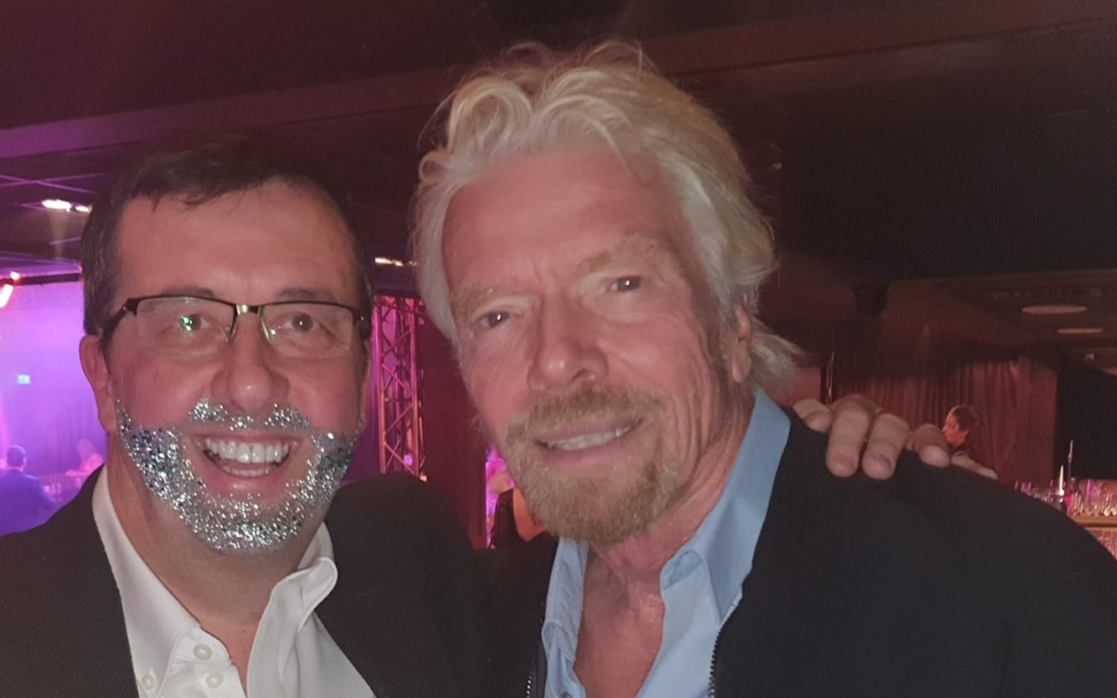 Richard Branson and Darren Jones wearing a glitter beard at Virgin Stars event