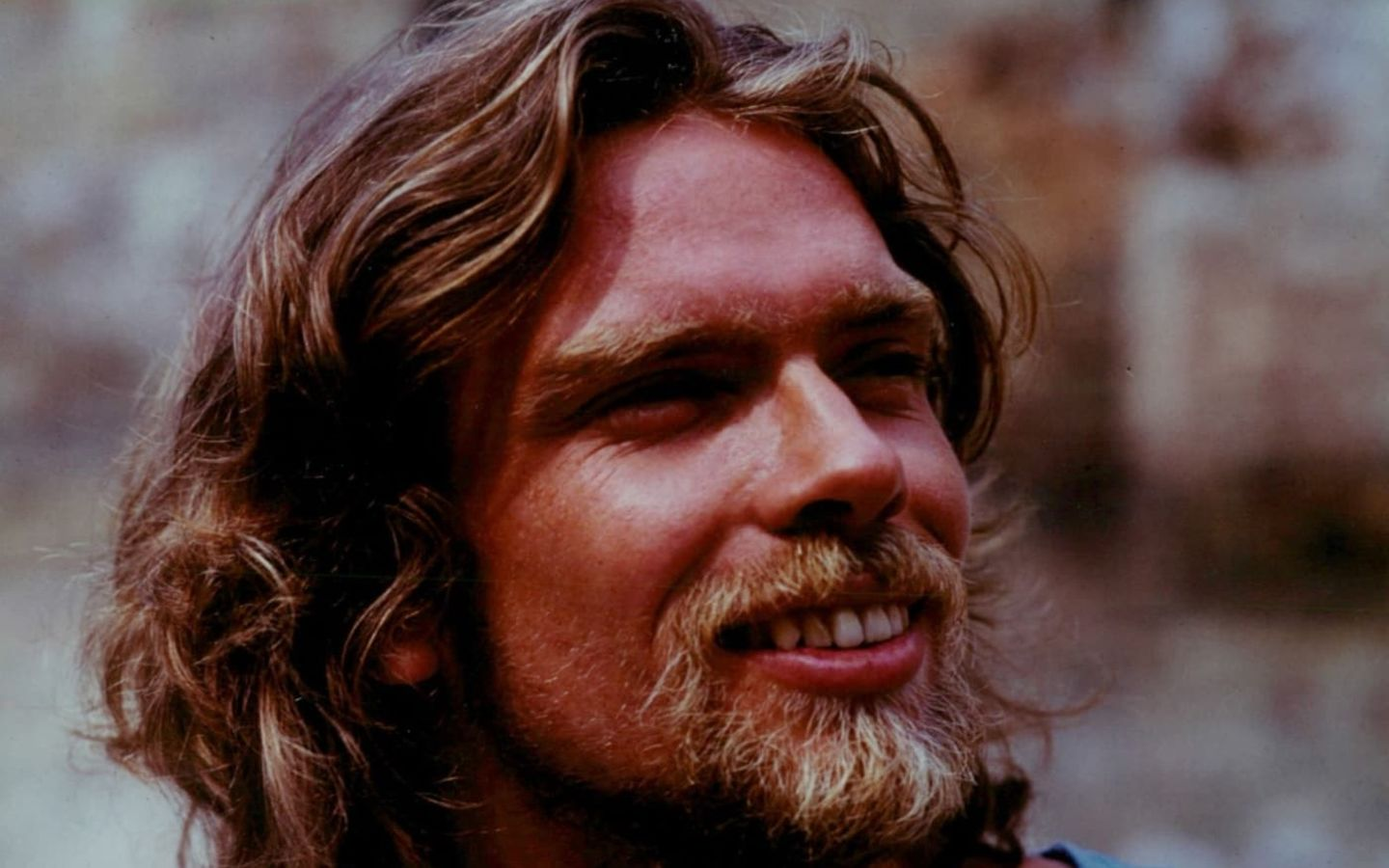 A close up of a young Richard Branson