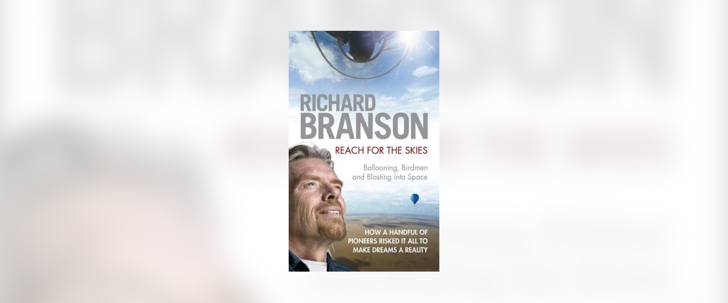 Front cover of Reach for the Skies by Richard Branson. He is looking towards the sky and there is a hot air balloon in the distance