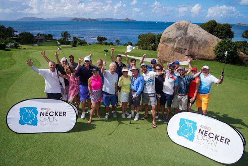 Richard Branson and the rest of the Necker Open contestants posing for the camera