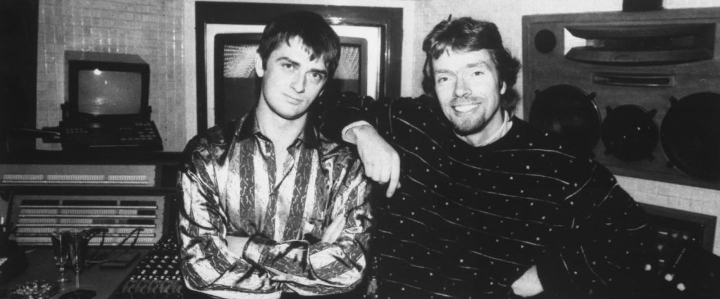 Black and white photo of young Richard Branson and Mike Oldfield