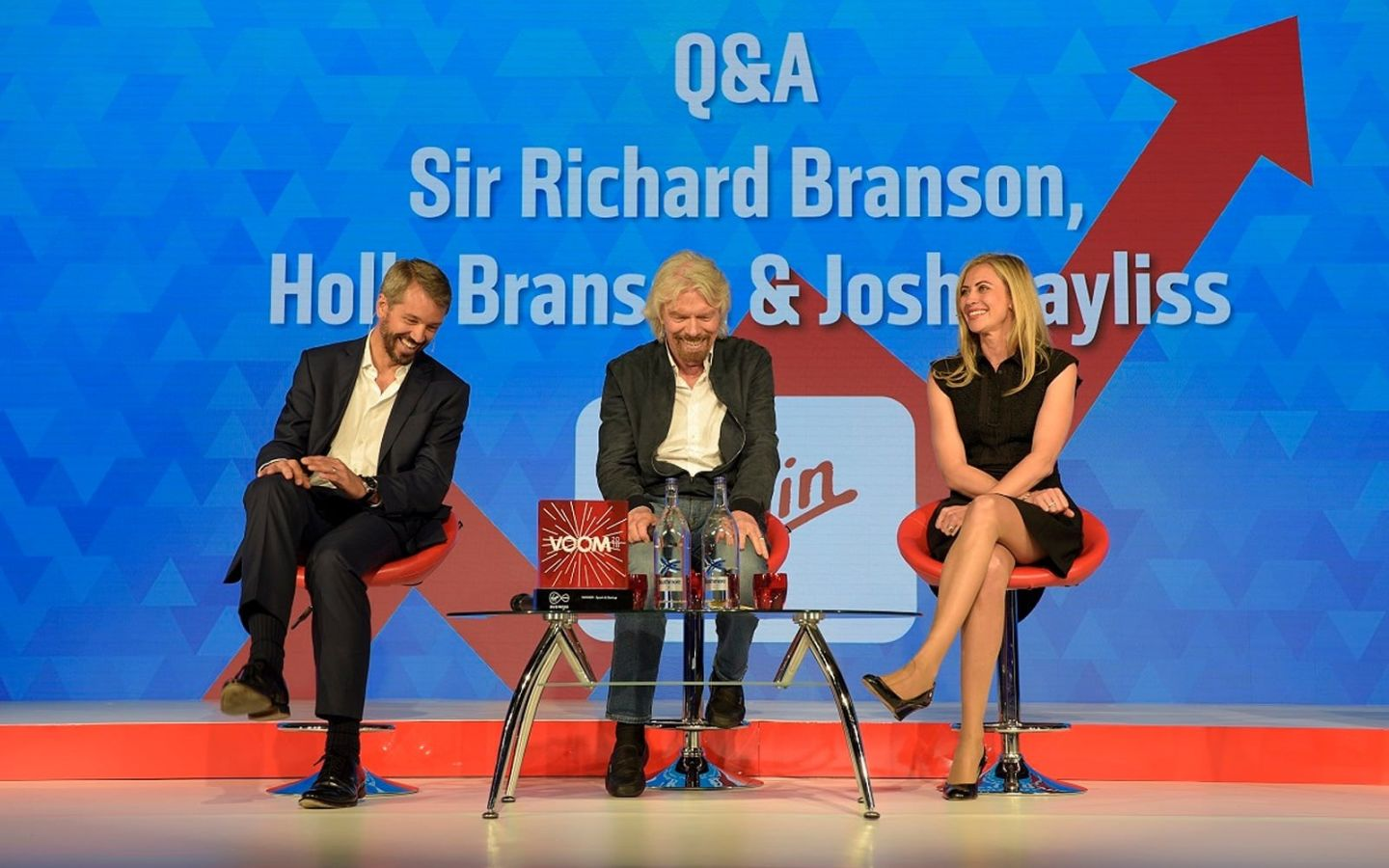 Richard Branson, Holly Branson and Josh Bayliss sit on stage ready for their Q&A session