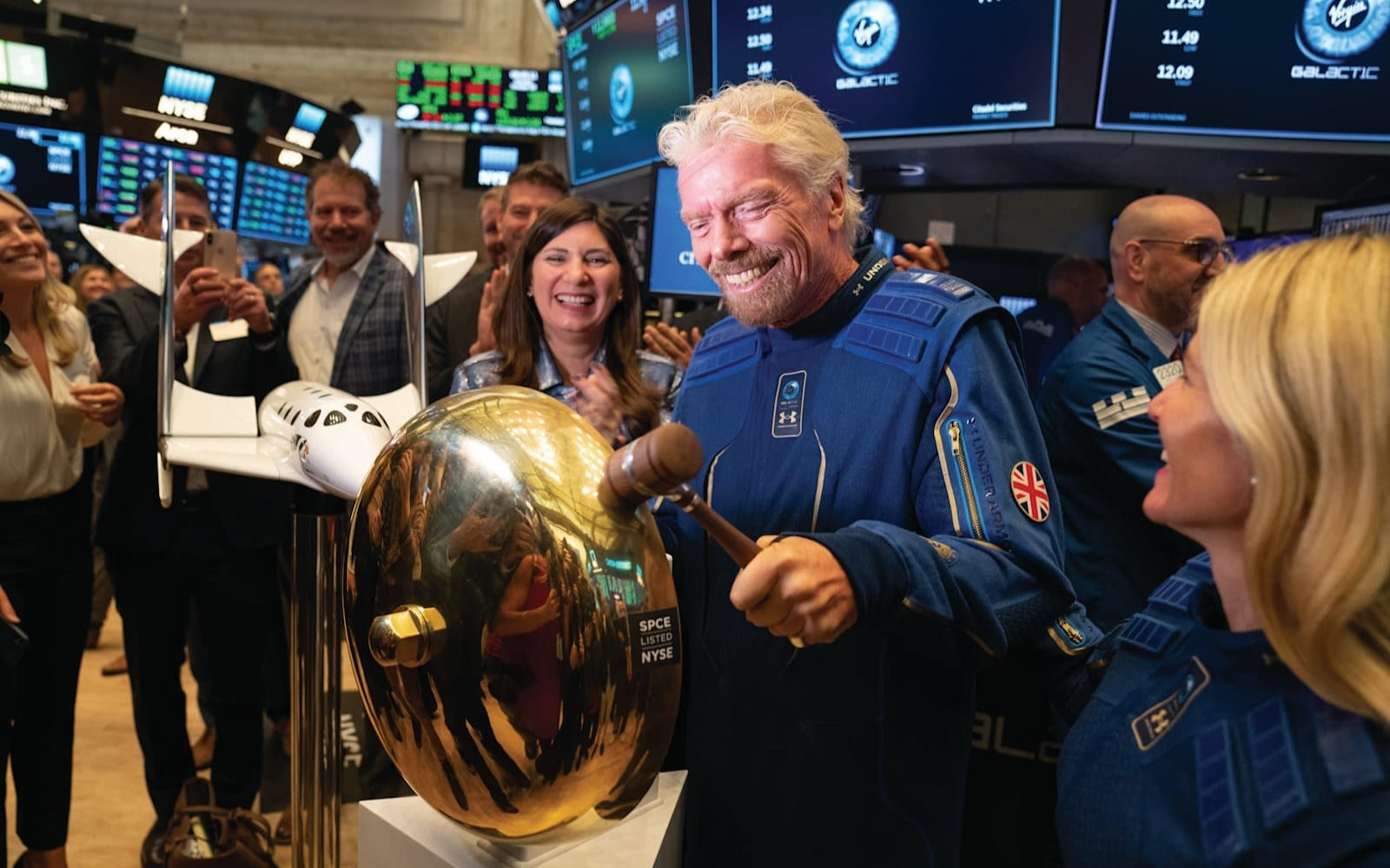 Richard Branson rings the bell at the New York Stock Exchange as Virgin Galactic is listed