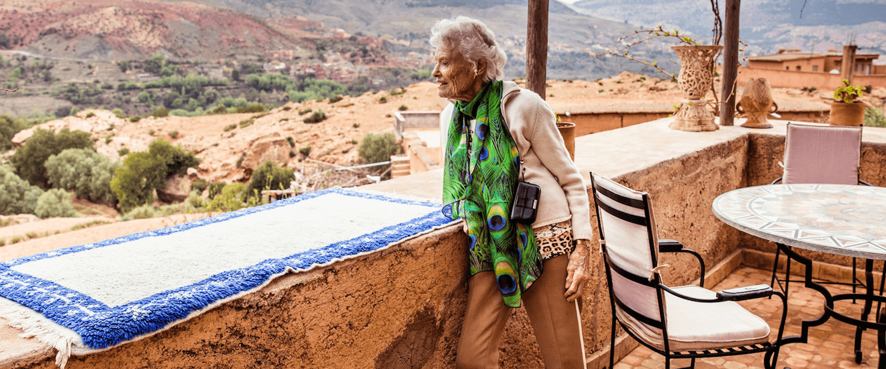 Eve Branson looking out over the Moroccan hillside from a balcony