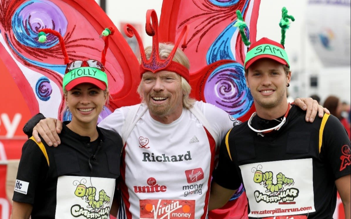 Richard Branson dressed as a butterfly, with Sam and Holly Branson, all running the Virgin Money London Marathon