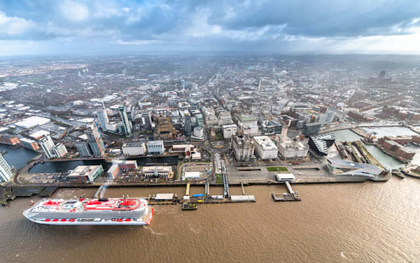 Aerial view of Virgin Voyages' ship Scarlet Lady docked in Liverpool