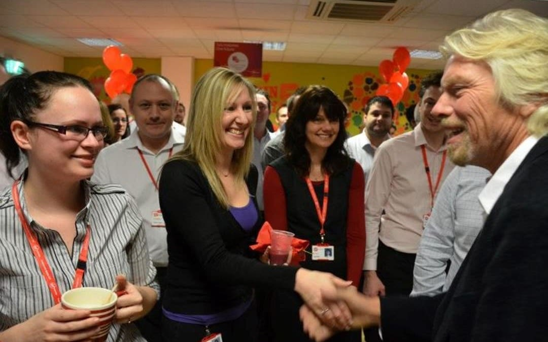 Richad Branson shaking hands with an event with Virgin Money