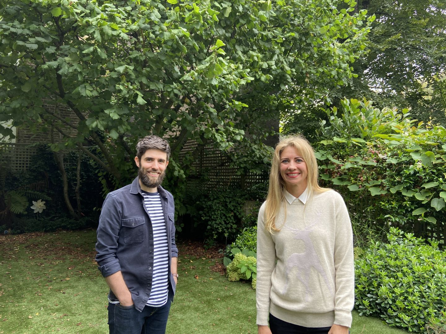 Holly Branson and Virgin StartUp CEO Andy Fishburn smiling in a garden