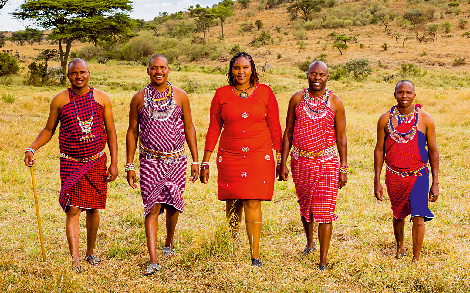 Virgin Limited Edition team members at Mhali Mzuri walking across a field