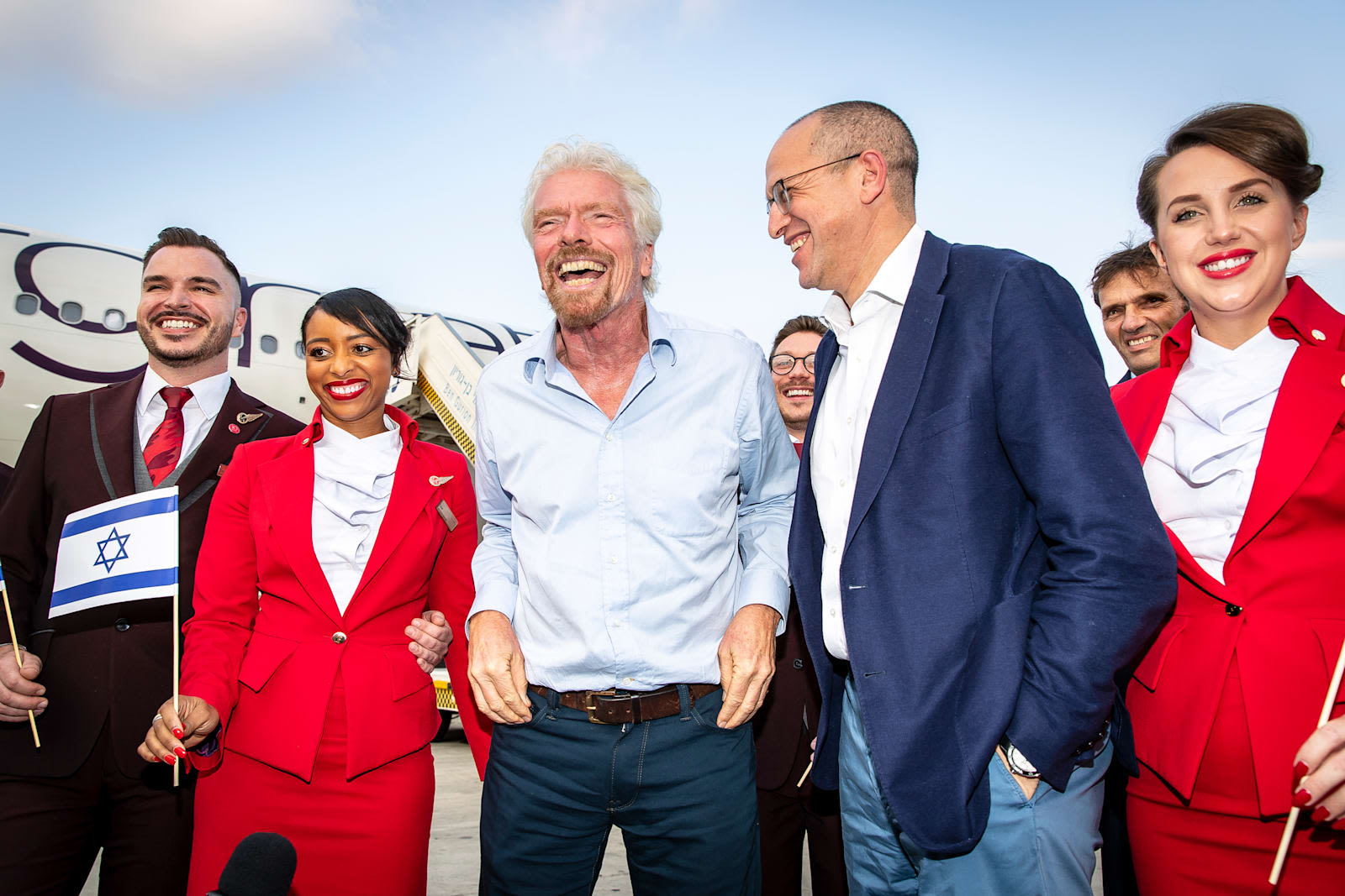 Richard Branson with Virgin Atlantic CEO Shai Weiss and Virgin Atlantic cabin crew celebrating the inaugural flight to Tel Aviv