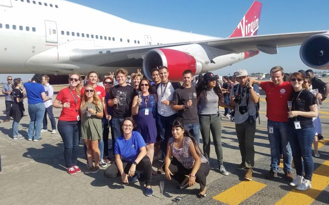 The class of 2017 Virgin Orbit interns in front of Cosmic Girl