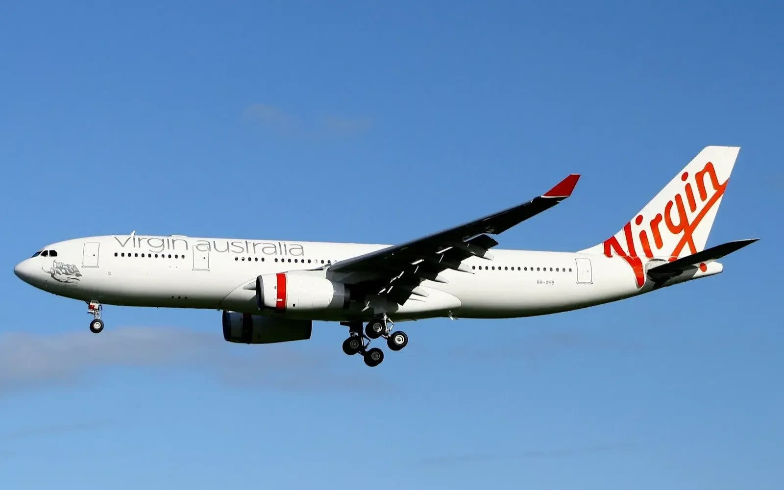 A Virgin Australia plane flying against a blue sky