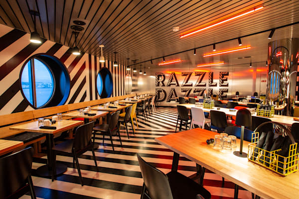 The Razzle Dazzle restaurant on-board Virgin Voyages Scarlet Lady ship