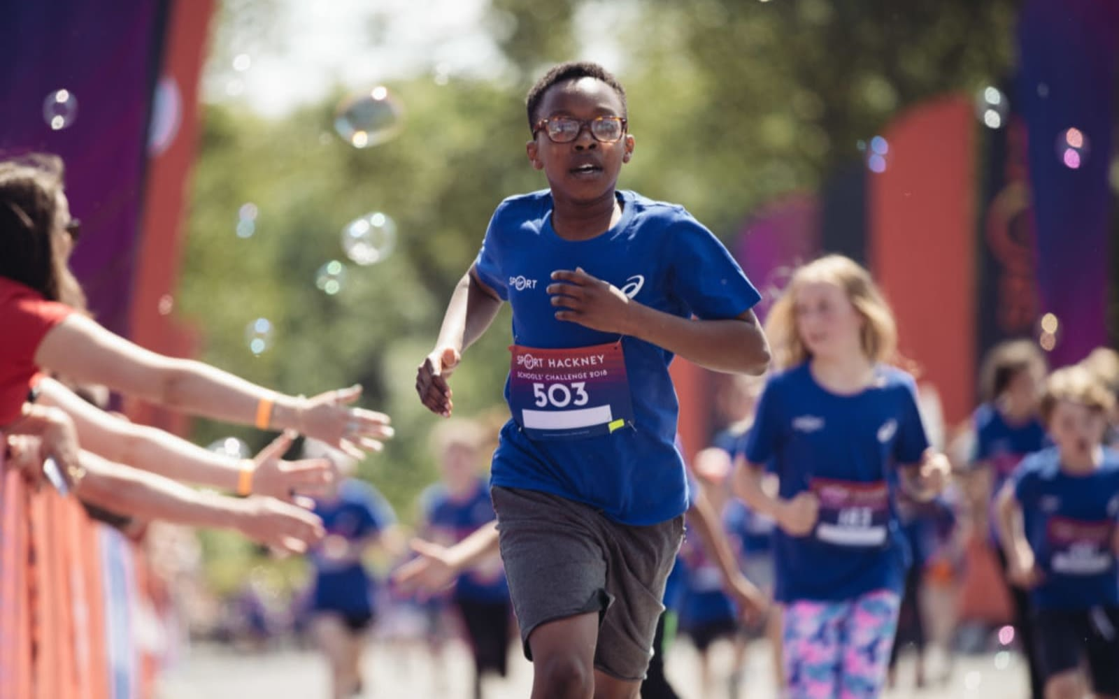 A child participant crosses the finishing line of the Wheetabix Protein Youth Challenge