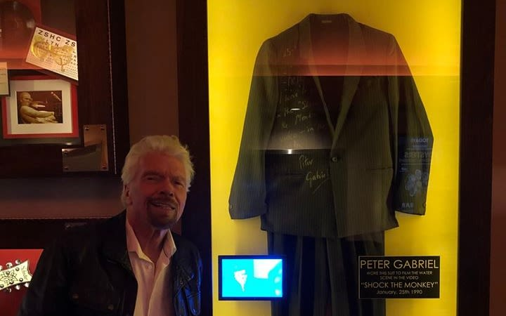 Richard Branson posing with Peter Gabriel's suit at the Hard Rock Hotel in Las Vegas, which will become Virgin Hotels Las Vegas