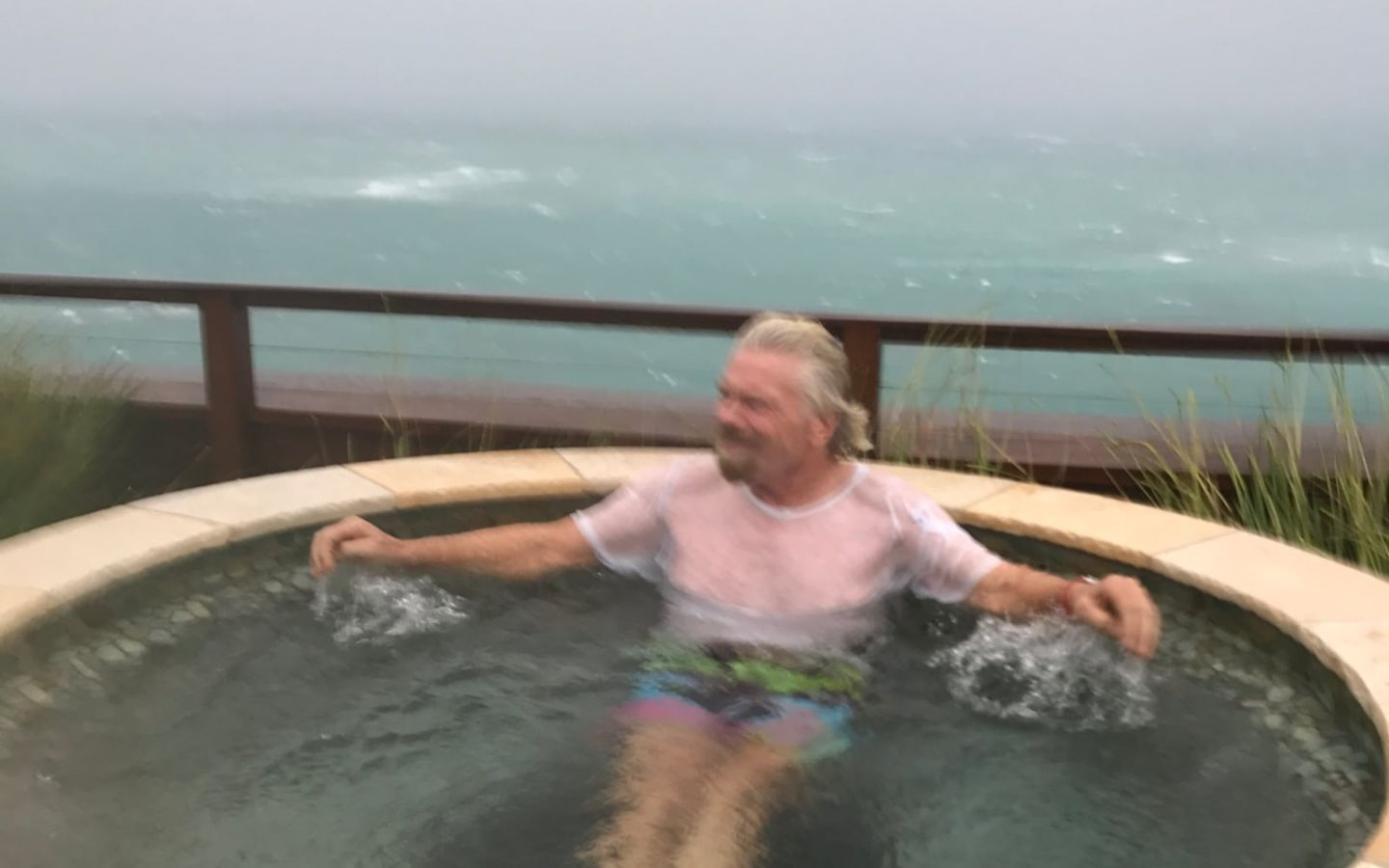 Richard Branson sitting in a hot tub on Necker island