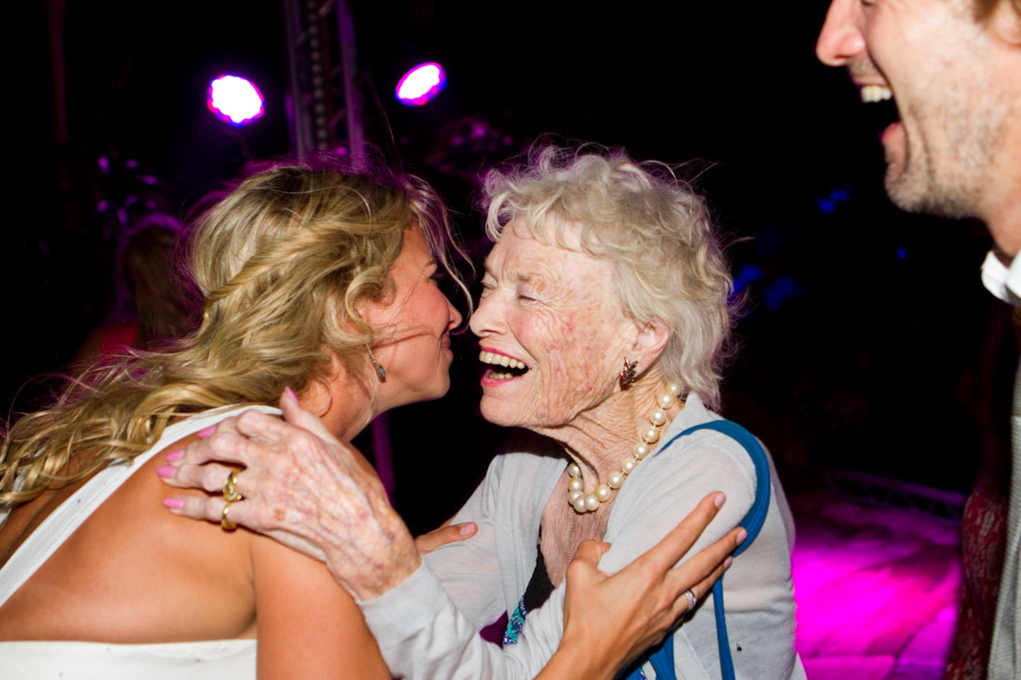Eve Branson and Holly Branson dancing and smiling at Holly's wedding