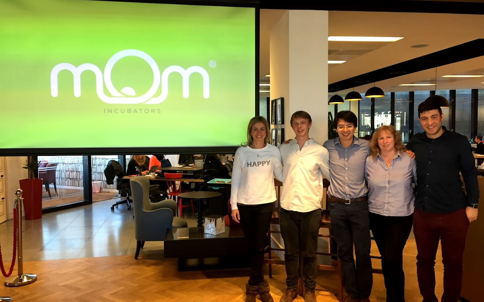 Founders of MOM with Holly Branson in front of a screen with the Mom logo